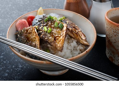 Saba mackerel fish grill with teriyaki sauce on rice in Japanese style.