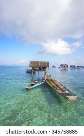 SABAH, MALAYSIA - APR 19: Unidentified Bajau Laut kids on a boat in Bodgaya Island on August 19, 2015. They lived in a house built on stilts in the middle of sea, boat is the main transportation here