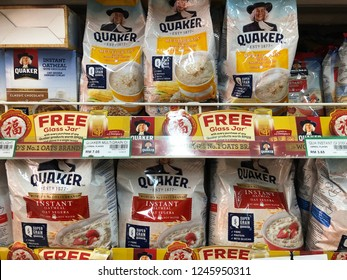 SABAH, MALAYSIA - DEC 1, 2018: Rows of Quaker outs instant oatmeal on shop shelf