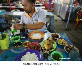 Sabah Malaysia - Dec 28, 2018 : Street scene at warung ikan bakar in Sandakan,Sabah.Malaysia.