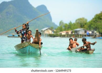 Sabah, Malaysia - December 02, 2018 : Their life is very simple.  The young boys and girls row their boats at Bogdaya Island, in Semporna, Sabah.