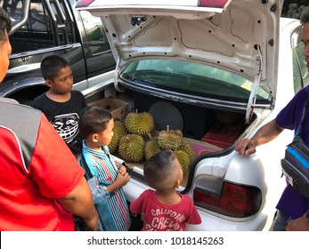 Sabah Malaysia - Feb 3, 2018 : Fruits vendor selling durian at roadside in Ranau. Durian is famous for its creamy taste and strong smell and sold at good price in local market.