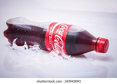 SABAH, MALAYSIA - JANUARY 13, 2015. Bottle of Coca-cola drink isolated on white. The Coca-Cola can, which dates back to 1915, is the most recognised packaging in the world today.