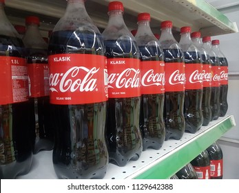 Sabah, Malaysia - July 4, 2018: Row a Coca cola soft drink bottle's display for sell in the supermarket shelves.