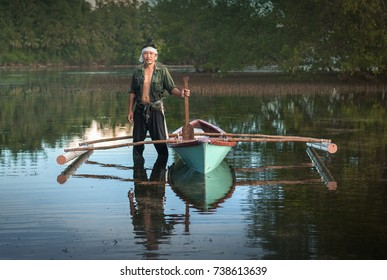 Sabah, Malaysia - June 24,  2017 : A local fisherman from Rungus tribe posing for camera before go out for fishing. Rungus is consider the most versatile tribe in North Borneo.