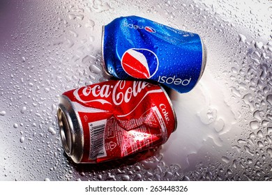 SABAH, MALAYSIA - March 18, 2015: Coca-Cola and Pepsi cans on metal background.