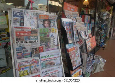 Sabah, Malaysia. March 4, 2017: Local newspapers and tabloids on display outside a local bookstore at Kota Kinabalu, Sabah.