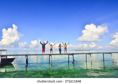 Sabah, Malaysia May, 11 2015 : Unidentified Borneo Sea Gypsy kids jump from the jetty in Salakan Island, Sabah Borneo, Malaysia. They living on long boats know as lepa lepa in the middle of ocean