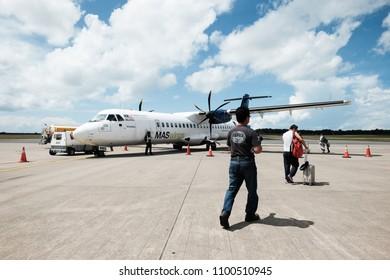 Sabah Malaysia - May 27, 2018 : Passenger boarding MasWings Aircraft ATR-72-500 at Tawau Airport . The aircraft serve regional destination within Borneo with a capacity of max 74.
