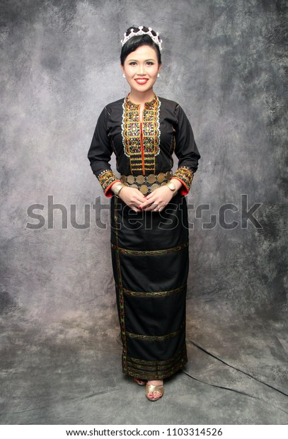 Sabah, Malaysia -May 27, 2018:Traditional costume of native North Borneo. Illustrative editorial.