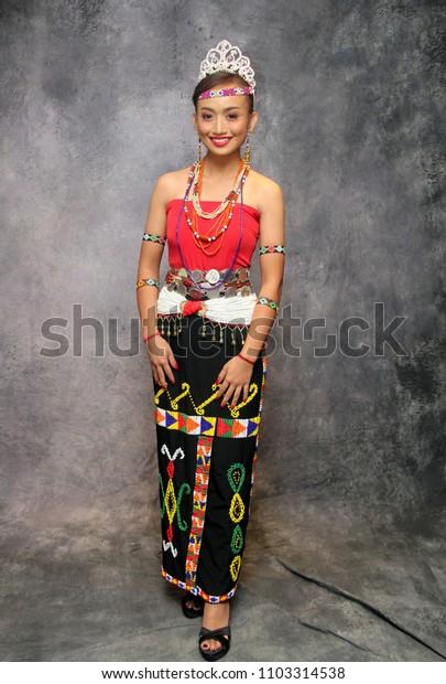 Sabah, Malaysia -May 27, 2018:Traditional costume of native North Borneo. Illustrative editorial.