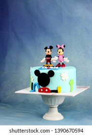 Sabah, Malaysia - May 6, 2019: Mickey mouse inspired cake with blue dark background.