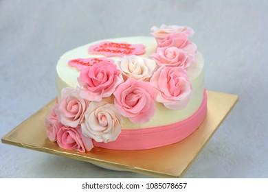 Sabah, Malaysia - May 7, 2018: Pink rose flower gum paste cheese cream cake.