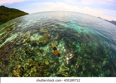 Sabah, Malaysia - Nov/04 2013 - Unidentified sea gypsy boy dive infront of Bohey Dulang Island.