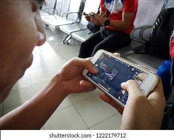 SABAH, MALAYSIA, NOVEMBER 6 2018 : Selective focus hand holding a smartphone with Player's Unknown Battleground also known as PUBG online shooting gaming