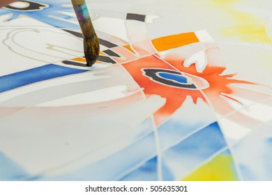 SABAH, MALAYSIA - October 23 2016 : Unidentified man use watercolor to color on the fabric to make Batik. Batik-making is part of Malaysia culture and tourist attraction in Sabah, Malaysia.