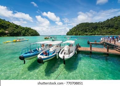 Sabah, Malaysia - October 6, 2017 : Boat at the Sapi Island. Sapi Island (Pulau Sapi) is the most visited island by tourists in Sabah.