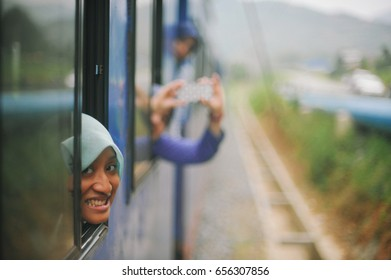 SABAH, MALAYSIA. SEPTEMBER 2015. tourist sitting at an old train window with spectacular view in Tenom, Sabah managed by Sabah State Railway