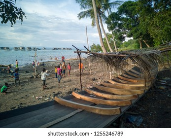 Sabah, Malaysia-Dec 01, 2018:Unidentified group of sea gypsy children playing a volley ball on the beach in Sipadan Bodgaya island, Semporna, Sabah, Malaysia.