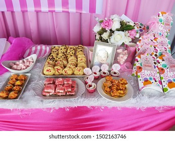 Sabah, Malaysia-February 24, 2018: Birthday party candy dessert table decoration pink theme with cookies and cakes display.