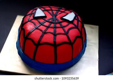 Sabah, Malaysia-May 17, 2018 : Spiderman inspired fondant cake art with black background.