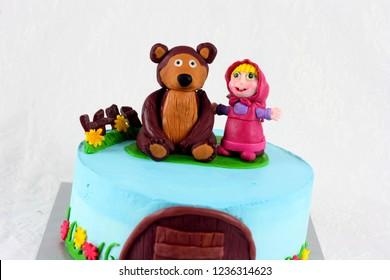 Sabah, Malaysia-November 11, 2018: masha and bear theme inspired cake for kids birthday party.