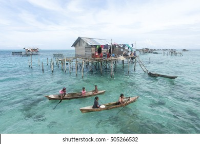 Sabah, Malaysia-Oct 20, 2012:Unidentified Borneo Sea Gypsy kids on a canoes in Mabul Sipadan Island, Sabah Borneo, Malaysia. They living on the long boats know as lepa lepa in the middle of ocean.