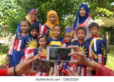 Sabah, Malaysia.September 15, 2017. Malaysian in costume with Malaysian flag pattern having group photo during Malaysia Day. Malaysia Day is to commemorate the estabilishment of Malaysian Federation.