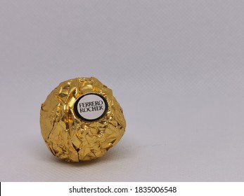Sabah/Malaysia-October 15 2020 : Photo of chocolate by ferrero rocher isolated on white background.Image may contain noise or grain due to low light.Selective focus.