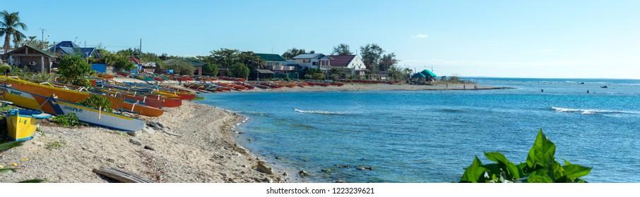 Sabang, Ilocos Sur, Philippines 30th December 2017. People on the beach enjoying