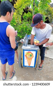 Sabang, Philippines-October 20, 2016: Street vendor sells ice cream in small plastic cups to tourists visiting the Puerto Princesa Subterranean River Nnal.park. Sabang town-Palawan island-Philippines.