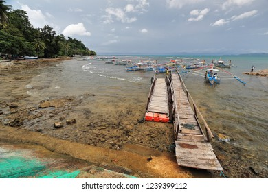 Sabang-Palawan, Philippines-October 20, 2016: Puerto Princesa Undeground River Nnal.Park ferry service boats wait at the pier for the tourists visiting the park to transport them to the river and back