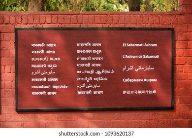 SABARMATI, AHMEDABAD, GUJARAT, INDIA, MAY 14, 2018: Sabarmati Ashram, written in 21 languages. A national monument from where Mahatma Gandhi managed the Independence movement.