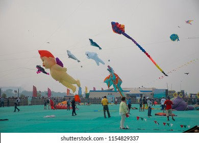 SABARMATI RIVERFRONT, AHMEDABAD, GUJARAT, INDIA, January 2018. People at the International Kite Festival