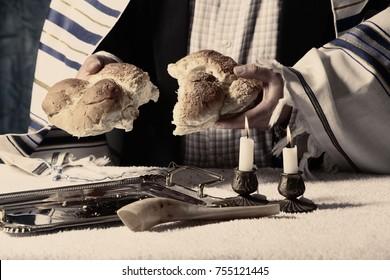 Sabbath image kiddush, crystal candlesticks with lit candles, and challah challahs