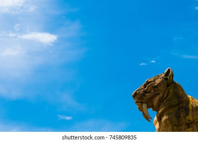 Sabertooth tiger statue in the lower right corner and an amazing blue sky