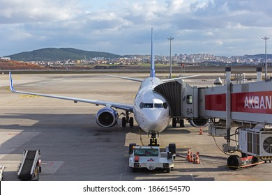 Sabiha Gokcen Airport, Istanbul, Turkey - February 16 2020: Front view of Boeing 737 jet from Anadolujet fleet connected with jet ridge on airport ramp.
