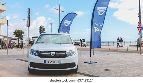 Sables d Olonne, France - May 07, 2017 : Dacia Tour 2017 is a commercial operation organized by the car builder in order to present its cars throughout France - A young man watching a car