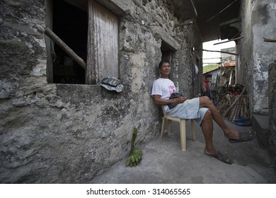 Sabtang Island, Batanes, Philippines-March 27,2015: Fisherman, Ceasar Cariz, 61, taking a rest outside his house in Sumnanga fishing village. People in this village a fisherman from Ivatan ethnic.