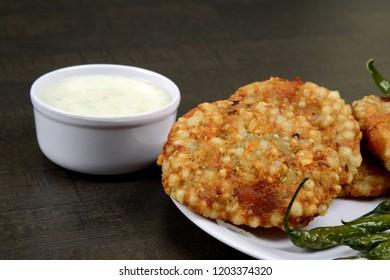 Sabudana Vada, Chutney with fried Green chilli, A maharashtrian food or Indian regional food