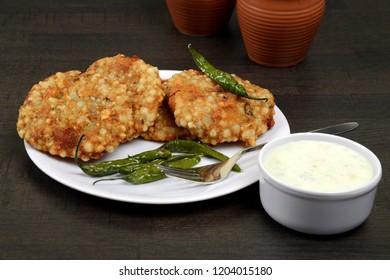 Sabudana Vada, Chutney and fried green chilli, A maharashtrian food or Indian regional food