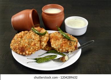 Sabudana Vada, Chutney, fried green chilli and Butter milk or matta, A maharashtrian food or Indian regional food