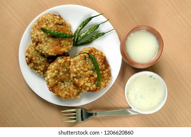 Sabudana Vada, chutney, fried green chilli and butter milk or matta, a Maharashtrian food or Indian regional food