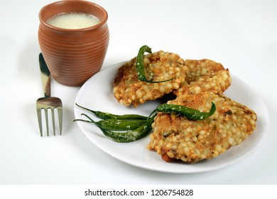 Sabudana Vada. Chutney, fried Green chilli and Butter milk or Matta, a Maharashtrian food or Indian regional food