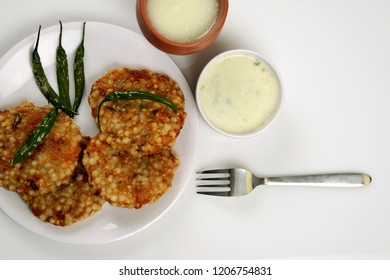 Sabudana Vada. Chutney, fried Green chilli and Butter milk or Matta, a Maharashtrian food or Indian regional food