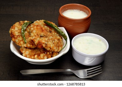 Sabudana Vada or Sago Cutlet with butter milk and fried green chilli