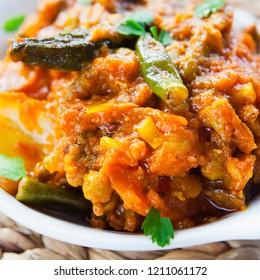 Sabzi Jhalfrezie -  Indian Cuisine Spicy Vegetable Curry - Asian cuisine vegetarian or vegan popular dish -  tomato, potato, okra, cauliflower, sweet potato, butternut squash, green peas and chilli