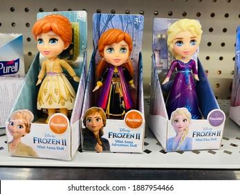 Sac, CA - December 19, 2020: Frozen 2 Anna and Elsa mini dolls on display on  a shelf.