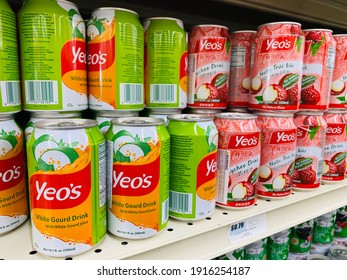 Sac, CA - February 13, 2021: Cans of Yeo's white gourd and lychee  drinks on supermarket shelf.