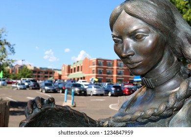 Sacagawea Statue Among Modern Structures